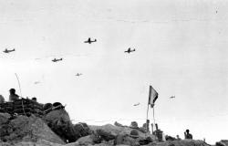 Photograph of gliders being towed over Normandy on D-Day.
