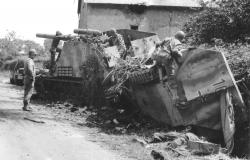 Members of the 2nd Armored Division are inspecting several enemy vehicles of the 2 SS Panzer Division in Saint-Denis-le-Gast. July 31, 1944. National Archives and Records Administration