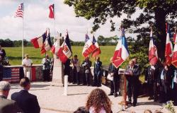 The unveiling of a memorial dedicated to the crew of Sweety Baby, as well as the crew and passengers of a C-47 that crashed in the same location, in Magneville, France. Courtesy of Mickaël Simon