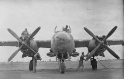 A ground crew from the 323<sup>rd</sup>Bombardment Group prepares a B-26 Marauder nicknamed Buffalo Gal, July 24, 1943. American Air Museum in Britain (FRE 1200).