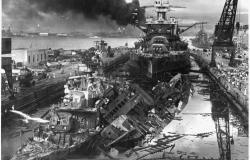 Clark was drafted in the months following the Pearl Harbor attack. This photograph shows the USS Cassin and the USS Downes in dry dock following the attack on Pearl Harbor, December 7, 1941. National Archives and Records Administration (295979)