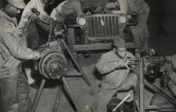 The 490th Port Battalion learning motor maintenance skills at the Unit Training Center in New Orleans, June 1943. Courtesy of  National Archives and Records Administration (172168)