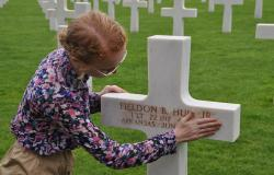 Megan McGinnis preparing First Lieutenant Fieldon B. Huie, Jr.'s headstone at Normandy American Cemetery, June 27, 2017. Courtesy of Cathy Gorn