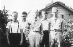 Joe McCabe (brother), Elmer McCabe (brother), Fred Lilley (step-father), Martin Malloy (brother-in-law), and William McCabe, 1943