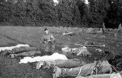 Father Sampson of the 501st PIR grants absolution to fallen paratroopers. Courtesy of NARA