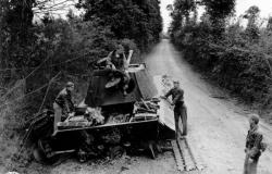 Soldiers examine a disabled German Panther Tank of the Panzer Lehr Division. July 1944. National Archives and Records Administration