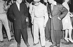 "Washington, D.C. Soldier inspecting a couple of ""zoot suits"". June 1942. Library of Congress (LC-USF34- 011543-D)"